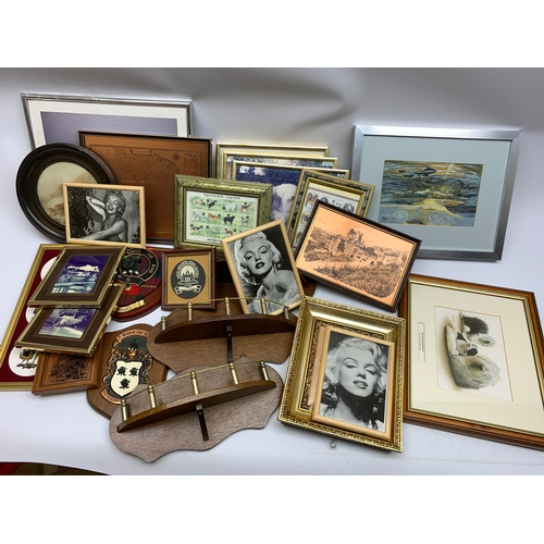674 - Three small wooden wall shelves, two wooden shield plaques, and a selection of frames, etc., in one ...