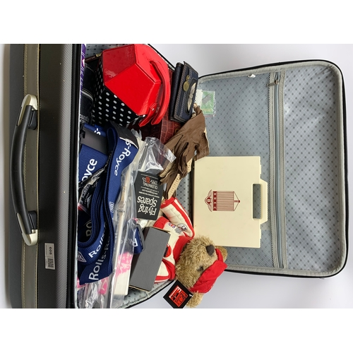608 - Large suitcase of items including car parts, teddy bear, med kit, whiskey case/holder and other smal...