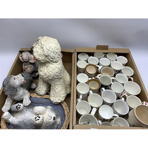 22 - Group of dog figures, to include large Old English Sheepdog, together with a selection of mugs decor...
