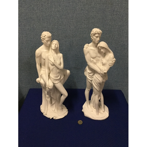 13 - 2 large painted couple figurines...
