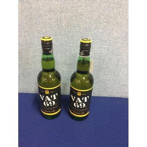 29 - 2 bottles of Vat 69 Scotch whisky...