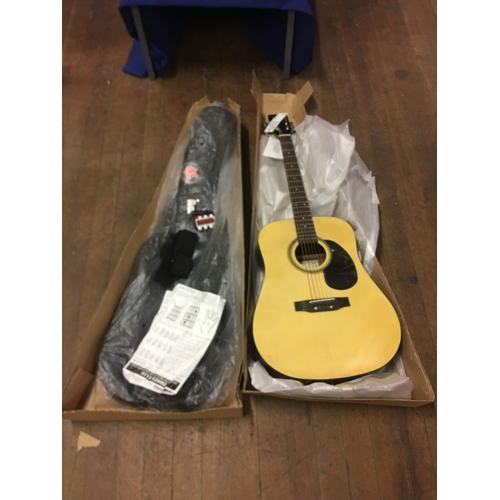 53 - New boxed Acoustic guitar and case...
