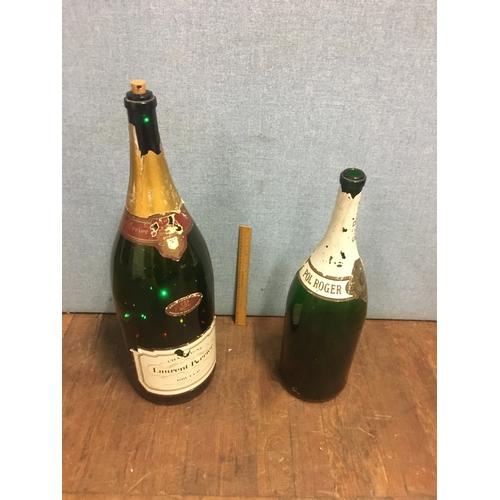 51 - 2 large, empty champagne bottles...