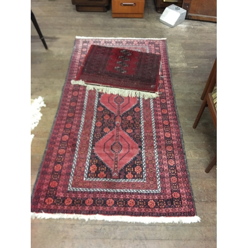 30 - 2 vintage hand woven rugs...