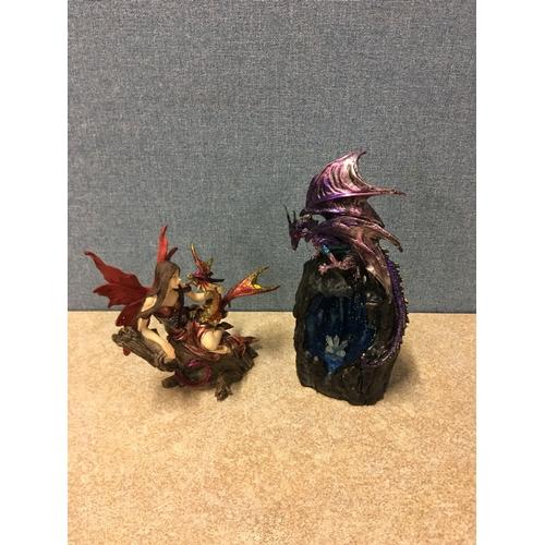 55 - 2 dragon ornaments...