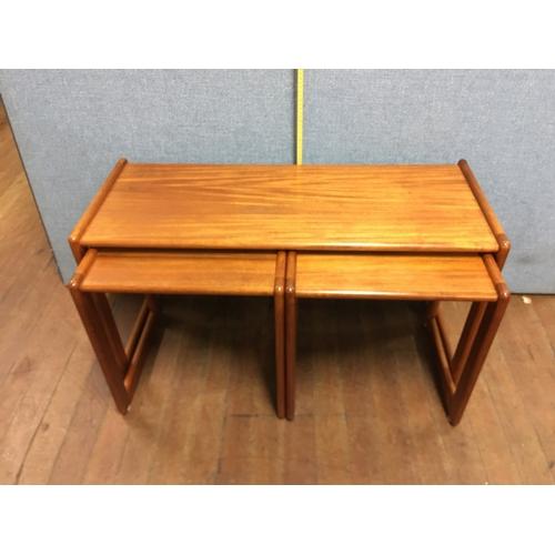 23 - Mid century teak nest of tables...