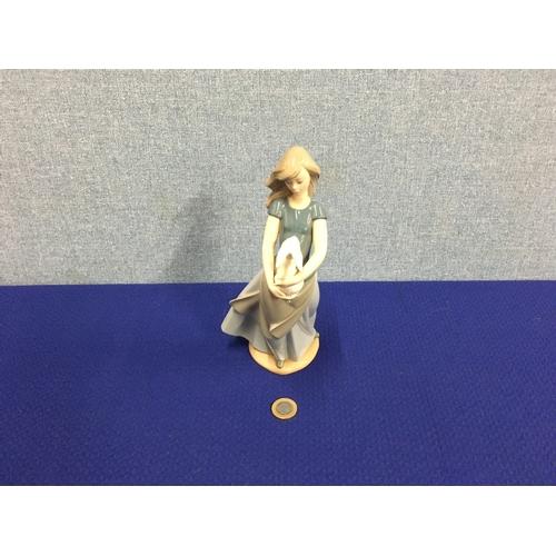 26 - Large Nao figurine....