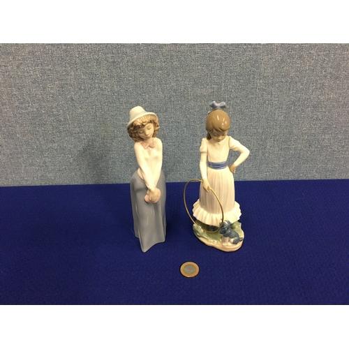 29 - 2 Nao figurines....