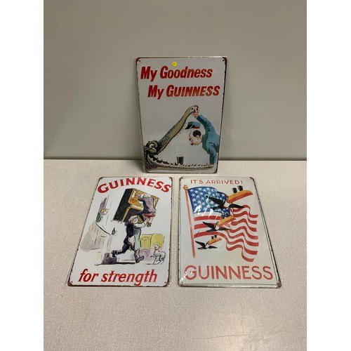 4 - 3 metal Guinness signs....