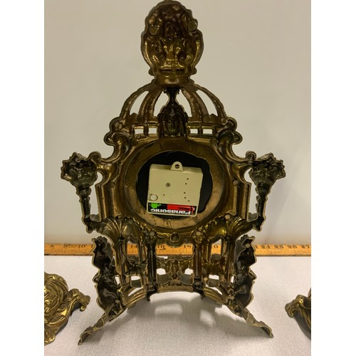 37 - Ornate brass mantle clock (battery operated) and garnitures....