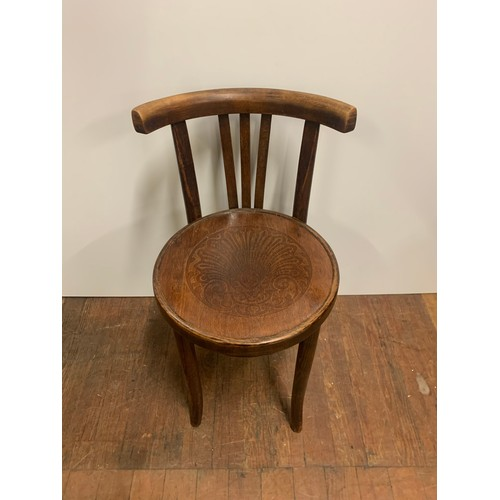 96 - Vintage bent wood chair with carved design on seat....