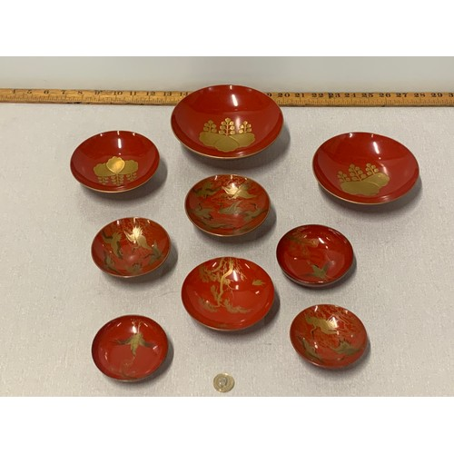 84 - Set of 9 Chinese red lacquered bowls with gold bird design....