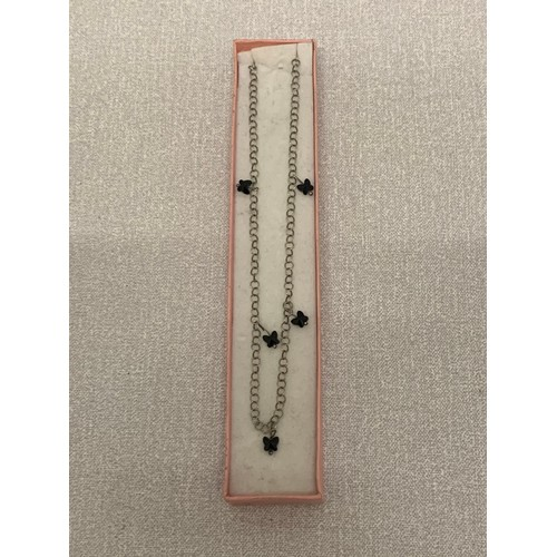 266 - Silver chain with butterfly charms....