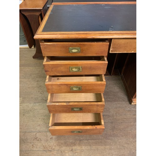 302 - Antique 10 drawer leather topped writing desk.