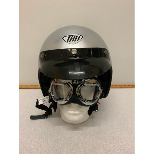 326 - New motorcycle helmet and goggles. Size large....