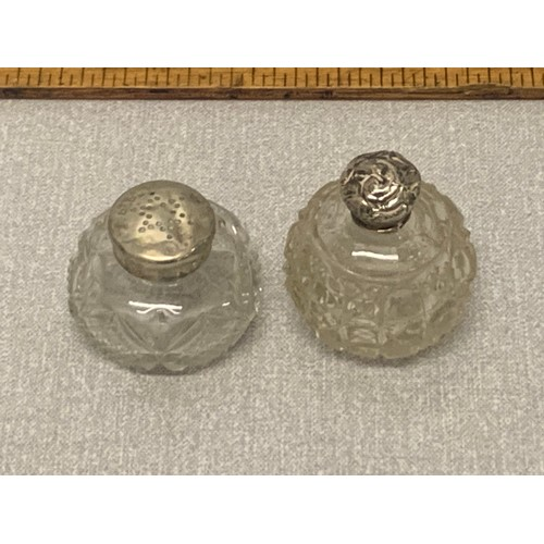 344 - Silver topped perfume bottle and silver topped pepperette....