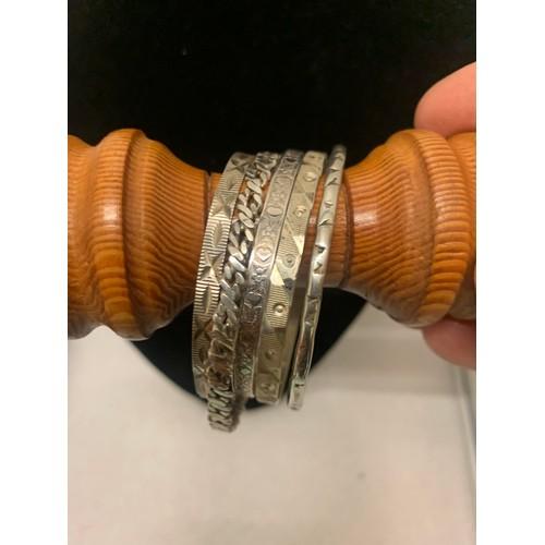 413 - 5 silver bangles....