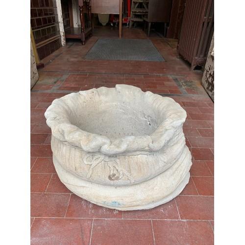 39 - Stone garden sack planter.