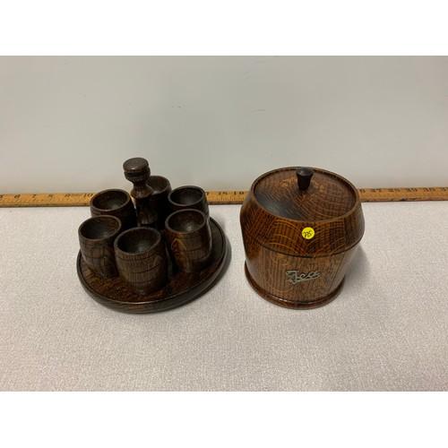 6 - Vintage wooden tea caddie and 6 barrel shaped egg cups on carrier.