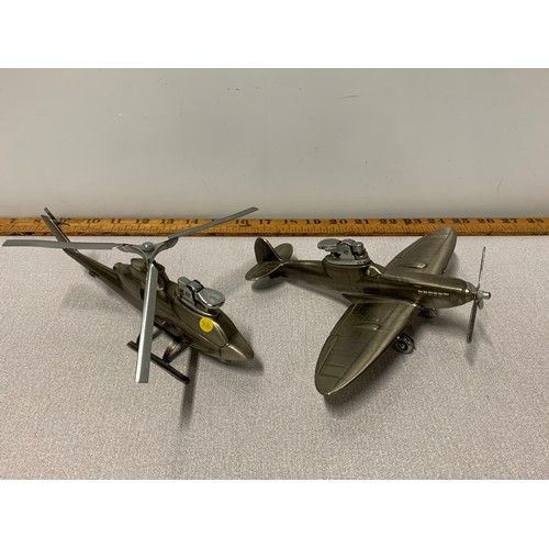 27 - Chrome helicopter and chrome Spitfire aeroplane desk/table lighters.