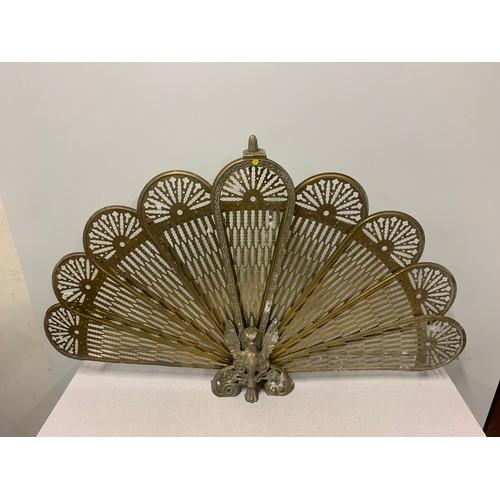 30 - Vintage, ornate Brass peacock folding fan fire screen. 56cm tall.
