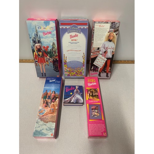 46 - 5 x boxed Barbie dolls and Barbie book.