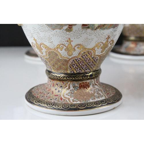 11 - <p>Set of Four Japanese Satsuma Style Twin Handled Lidded Urns, 34cms high</p>...