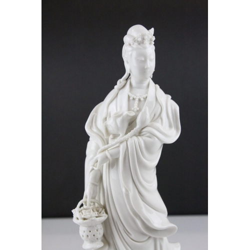 17 - Chinese Blanc de Chine Figure of Guanyin, 31cms high together with a Blanc de Chine Dog of Foe, 12cm...