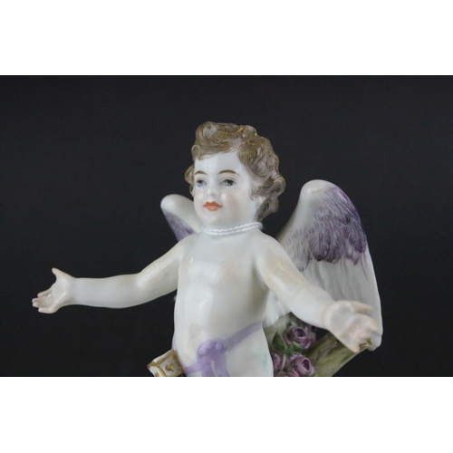 20 - Meissen Porcelain Figure of Cupid with open arms, the base decorated with gilt scrolls, blue cross s...