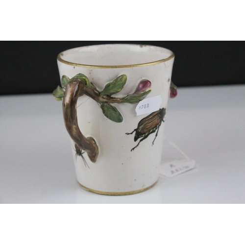 22 - Pair of 19th century Continental Glazed Stoneware Twin Handled Mugs, the handles in the form of foli...