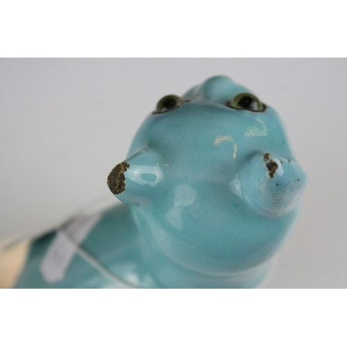28 - In the manner of Galle, A Mosanic Pottery Seated Cat, glazed in yellow with blue painted hearts and ...