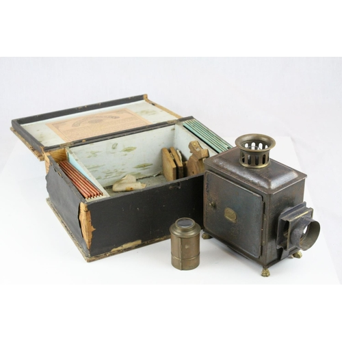 44 - Late 19th / Early 20th century German E.P. Paraffin Magic Lantern with twelve slides fitted in it's ...