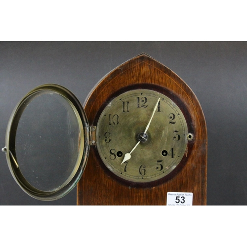 53 - Early 20th century 8 Day Mantle Clock contained in an Oak Arched Case with Brass Face, 30cms high...