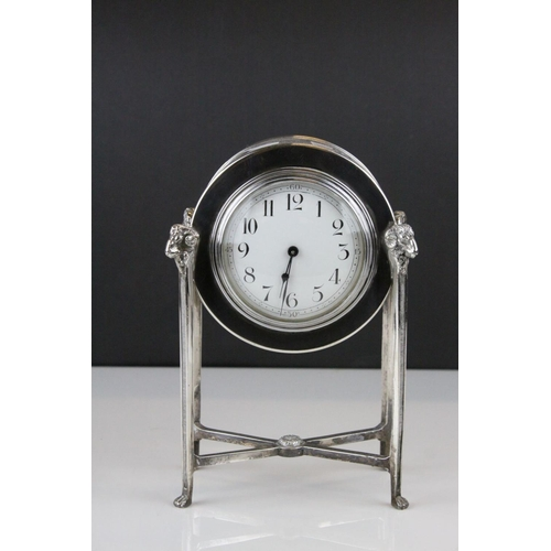 54 - French Empire Style Mantle Clock contained within a Silver Plated Case raised on square pillar suppo...
