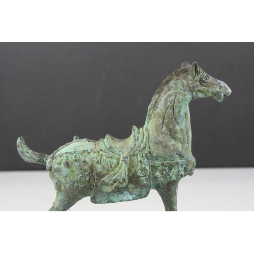 57 - Chinese Tang Style Metal Horse with patinated finish, 19cms long...