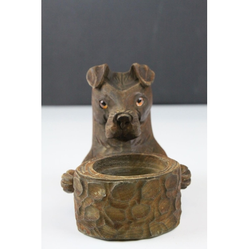 58 - A black Forest style dog matchbox holder and ashtray with glass eyes....