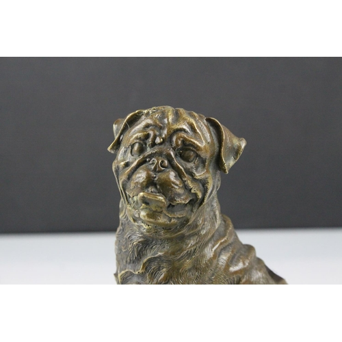 59 - A bronze seated Mastiff  dog figure 18 cm tall....