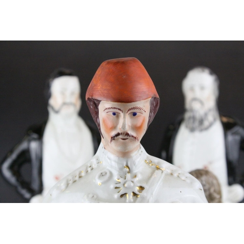 8 - Three 19th century Staffordshire Figures of Sankey, Moody and General Gordon, 42cms high together wi...