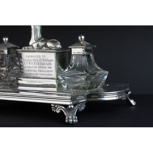 11 - Victorian silver double ink and pen desk stand, the central compartment with cast Sphinx surmount an...
