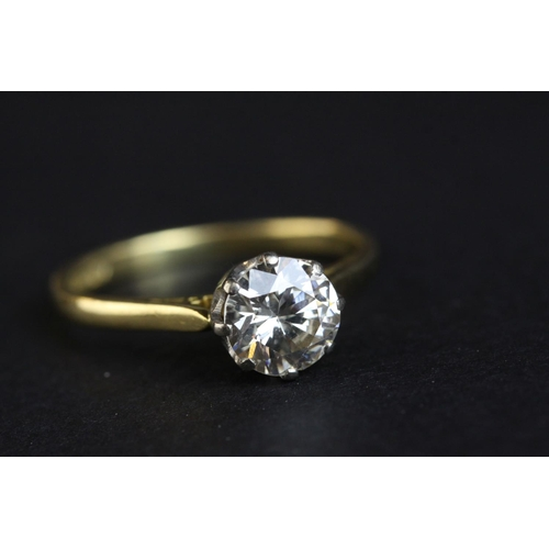 12 - Diamond solitaire 18ct yellow gold ring, the round brilliant cut diamond weighing approx 1.50 carats...