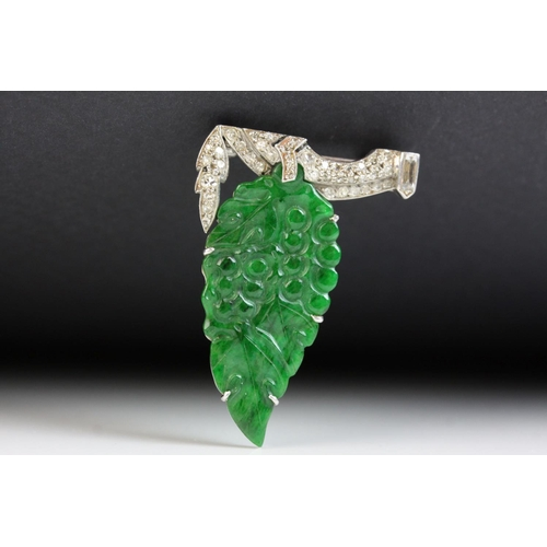 17 - Art Deco jade type and diamond white metal brooch, carved grape and leaf design with small round eig...