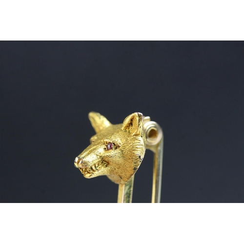 18 - Edwardian fox head 9ct gold tie pin/ bar brooch, the fox head with ruby eyes, early safety catch fas...