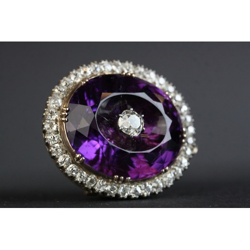 3 - Victorian amethyst and diamond pendant brooch, the large oval faceted amethyst measuring approx 20.5...