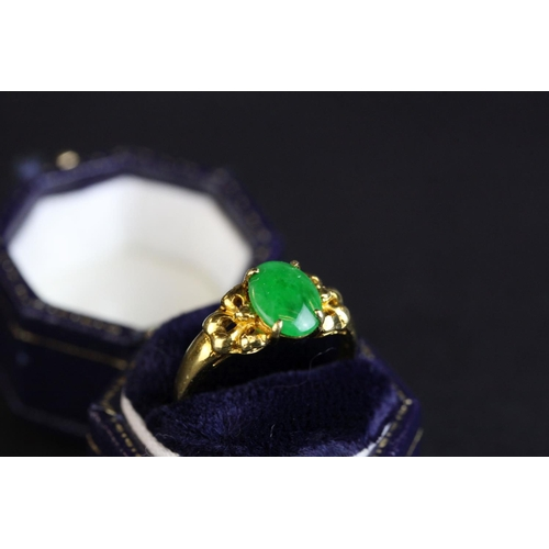 31 - Jade 18ct yellow gold ring, oval cabochon cut jade measuring approx 9mm x 6.5mm, pierced stylised sh...