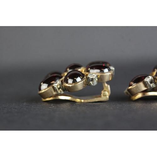 38 - Garnet and diamond yellow gold flower head earrings (Arabic markings) central round cabochon cut gar...