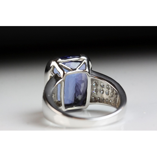 40 - Tanzanite and diamond 18ct white gold ring, the cushion cut tanzanite with certificate stating weigh...