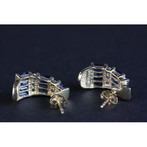 41 - Diamond and sapphire 10ct yellow gold half hoop stud earrings, tapered design, nine baguette cut cha...