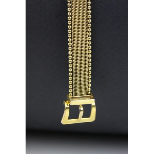 49 - Victorian 9ct yellow gold bracelet in the form of a belt, buckle clasp, textured strap with bead bor...