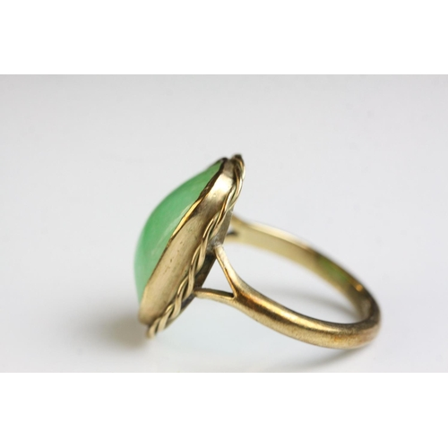 54 - Jade 9ct yellow gold dress ring, the rectangular cabochon cut jade measuring approx 16mm x 10mm, rub...