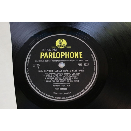 445 - Vinyl - The Beatles 2 LP's plus the Beatles Hits EP.  LP's Help! and Sgt Pepper both early copies wi...